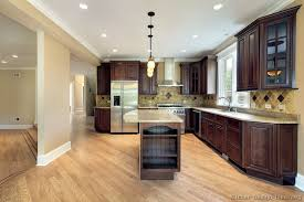 Kitchen Color Ideas With Cherry Cabinets Dark Cherry Cabinets Maple Hardwood And Light Countertops