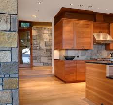 contemporary wooden kitchen cabinets and black marbles countertop