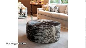 Funky Ottoman Furniture A Funky Cowhide Ottoman With Plated Color Touching