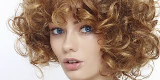 curly lob hairstyle 5 trendy medium hairstyles matrix