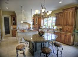 kitchen with an island kitchen with an island also panel appliances with pendant lamps in