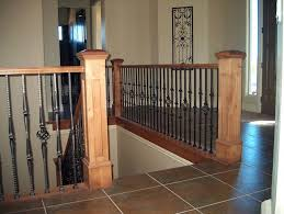 Banister And Spindles Wood Railing With Wrought Iron Balusters Traditional Staircase