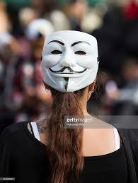 Guy Fawkes Mask Halloween by Woman Wearing Anonymous Mask Backwards Pictures Getty Images