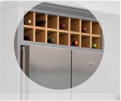 920 wide x 300mm high above fridge wine rack