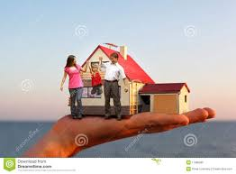 model of hous on hand and family stock photo image 17886890