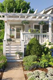the front porch of this craftsman bungalow faces south so it