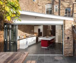 inside outside kitchen contemporary with brick splashback