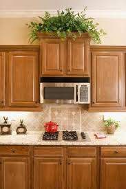 how to paint kitchen cabinets veneer how to paint veneer on cupboards