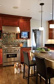 a garage turned family room old house restoration products in the kitchen bruce kept the existing cabinets intact but added a mosaic
