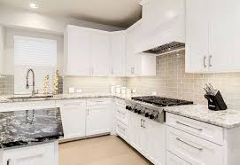 White Glass Backsplash by Gray And White Granite Countertops Transitional Kitchen