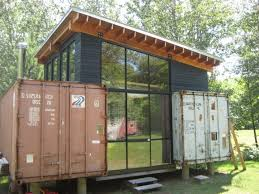 the nest home is a prefab made from recycled shipping containers