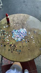i made a mosaic tabletop using broken cds finishing it before
