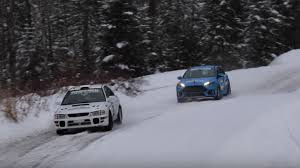 subaru drift snow a stock ford focus rs can hold its own against an old subaru rally