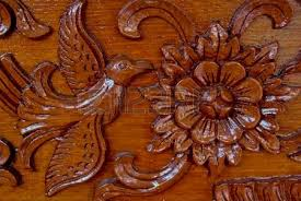 wood sculpture designs wood carving holes through flowers stock photo picture and