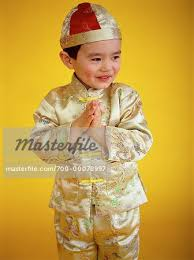 new year attire portrait of boy dressed in new year attire stock photo
