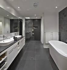 bathroom white cabinets dark floor bathroom floor to roof charcoal tiles with a black counter and grey