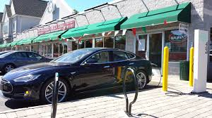 tesla electric car how much does it cost to charge an electric car plug in