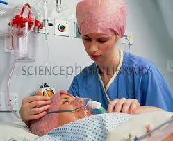 recovery room nurse woman with oxygen mask in post op recovery room stock image m555