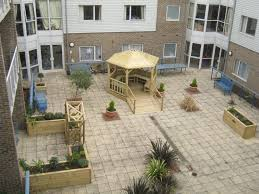 care home courtyard including gazebo with wheelchair accessible