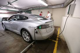 electric cars tesla china will consider resumption of new electric car permits bloomberg