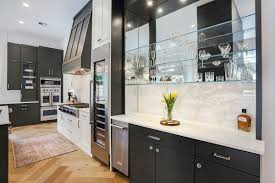 glass shelf between kitchen cabinets kitchen showcases the balance kitchen bath