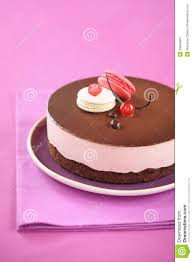 chocolate cherry mousse cake with macarons stock photo image