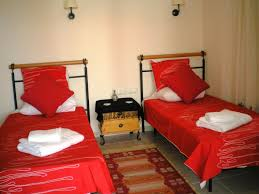interior bedroom modern double single bed red cover bedding with