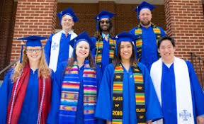 kente stole honorees don special stoles in preparation for emu commencement