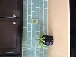 stunning blue glass tile backsplash on kitchen with green subway