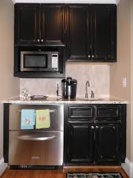 Cream Distressed Kitchen Cabinets New Cream Kitchen Cabinets With Stainless Steel Appliances Taste