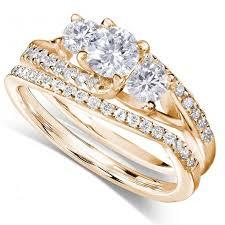 gold wedding ring sets 1 carat trilogy diamond wedding ring set in yellow gold