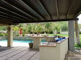exterior swimming pool design ideas with pergola covers plus tile