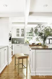 the kitchen boasts cabinetry by pilgrim s custom cabinets and the kitchen boasts cabinetry by pilgrim s custom cabinets and construction a hickory chair stool pulls