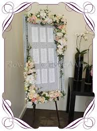 hire vintage pastel table seating frame photo board flowers