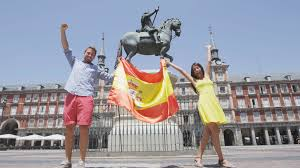 Spain Flags Spanish Flag People Jumping Showing Spain Flag In Madrid On Plaza