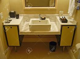 a modern or contemporary bathroom counter and sink stock photo