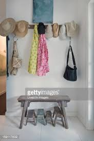 coat rack and bench in entrance hall stock photo getty images