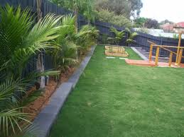 decor small backyard landscape ideas using green grass and stone