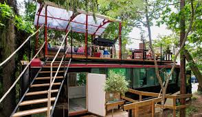 bus converted into cabin with rooftop deck