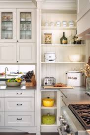 To Give This Kitchen A Farmhouse Style The Designer Used A - Kitchen shelves and cabinets