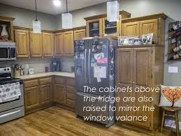 how to make cabinets appear taller my designer secret for updating kitchen cabinets