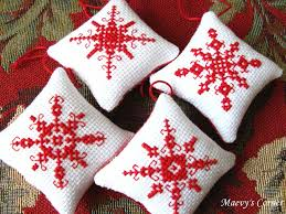 cross stitched ornaments small cross stitch red fabric and
