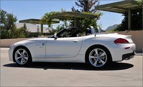 bmw sport car 2 seater bmw z4 reviews bmw z4 price photos and specs car and driver