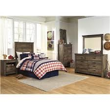 signature design by ashley trinell rustic look twin bookcase bed