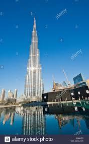 Burj Khalifa Burj Khalifa In A Sunny Day Reflection In Water Dubai Stock Photo