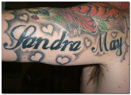 girly black and gray tattoos design around a name