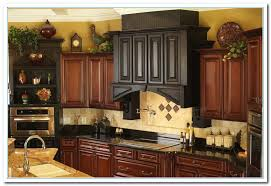 how to decorate kitchen cabinets kitchen cabinets decor quicuacom above cupboard decorating ideas