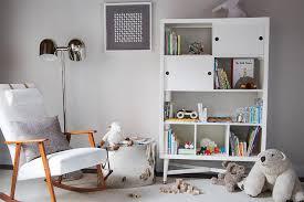 2 light floor l modern nursery features a mid century modern rocker next to a chrome