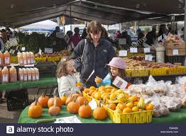 people shop at the grand army plaza farmers market in park slope