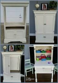 diy craft armoire with fold out table easy to make drop down work table this is for our craft room and